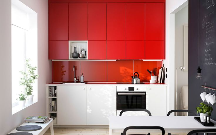 A red METOD kitchen with red and white fronts, a red worktop and an open cabinet.