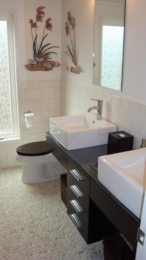 Polished White Pebble Tile bathroom floor hopefully new bathroom is along these lines