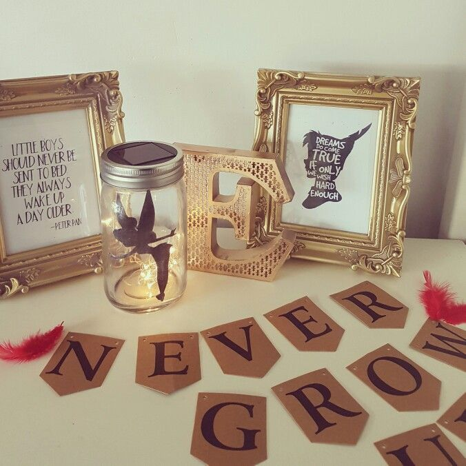 Used the E from a love sign I had   Also used a mason jars with solar powered led lights cut out a black tinkerbell silhouette and stuck to the inside of the jar  Sprayed some cream frames gold and printed off some peter pan quotes  and used d.i.y bunting i already had to spell out a peter pan quote will attach red feathers either side