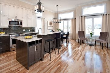 Cream rather than stark white for upper cabinets feels warmer. They also chose a dark backsplash instead of light. Countertops remind me of yours a little. White Upper Cabinets Design Ideas, Pictures, Remodel, and Decor - page 16