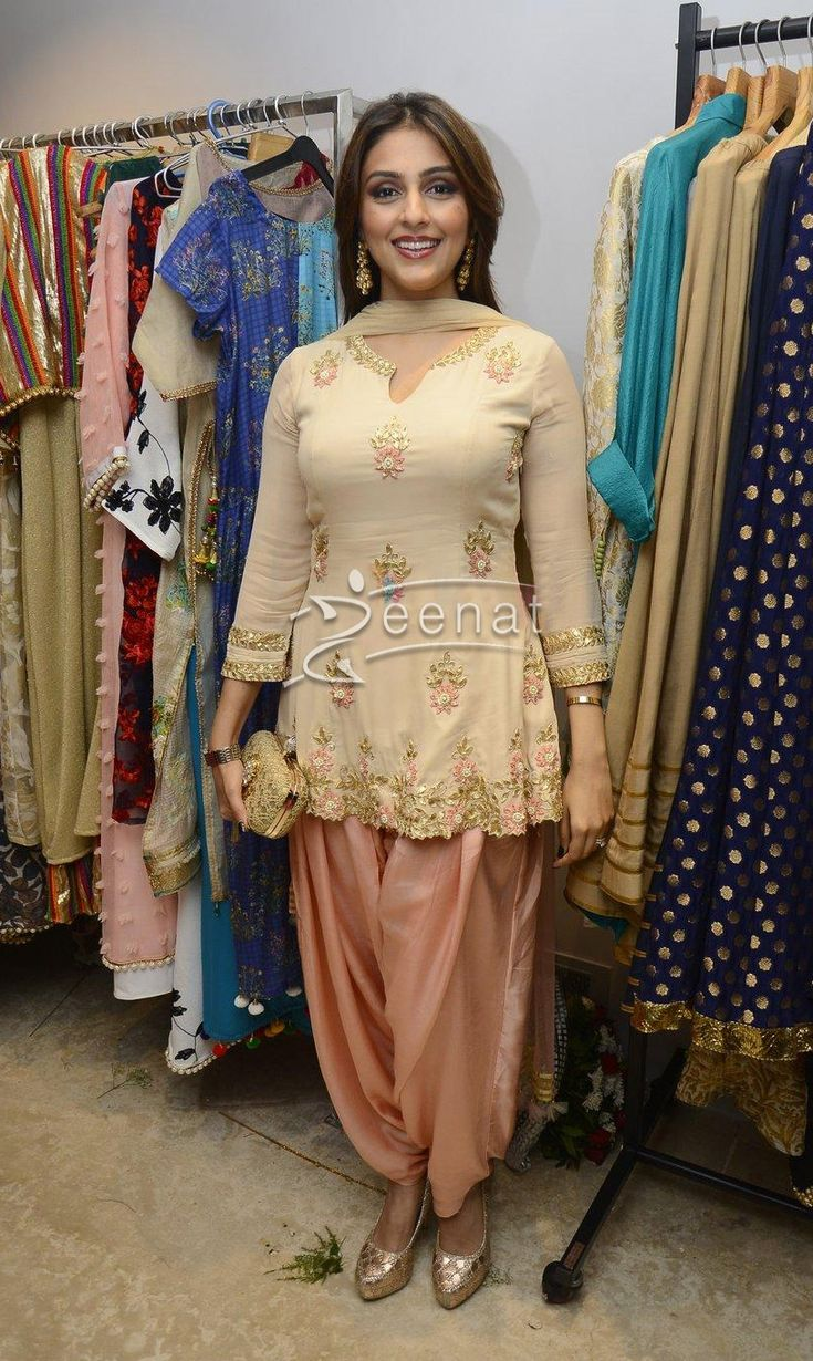 Good example of how you can cheapen an outfit even if you might be beautiful like this lady. Dupatta thrown to the back, the goods IN YOUR FACE and everything too tight for your size as well as the wrong length that makes you look shorter.