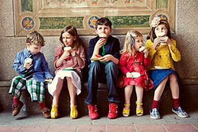LOVE the way these kids are dressed for their family portraits. Moms, take note-- they are all dressed in different outfits, and complimentary bright colors. And, yep... there are even patterns! Don't be afraid to make bold choices with clothes and show off your child's individuality!