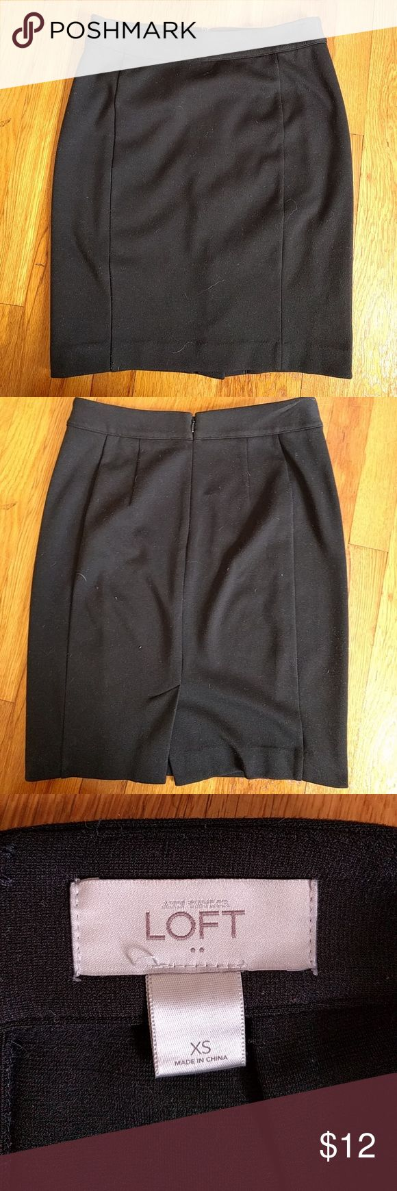 """LOFT XS stretchy black pencil skirt Excellent condition black pencil skirt from the LOFT factory store. Stretchy and comfortable with back slit. Hook closure is missing a piece (as shown) and price reflects that. Waist measures 14"""" across, length is 19.5"""". LOFT Skirts Pencil"""