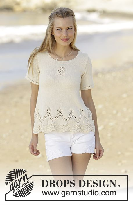 Top with wave pattern and lace pattern, worked bottom up in DROPS Safran. Sizes S - XXXL. Free pattern by DROPS Design.
