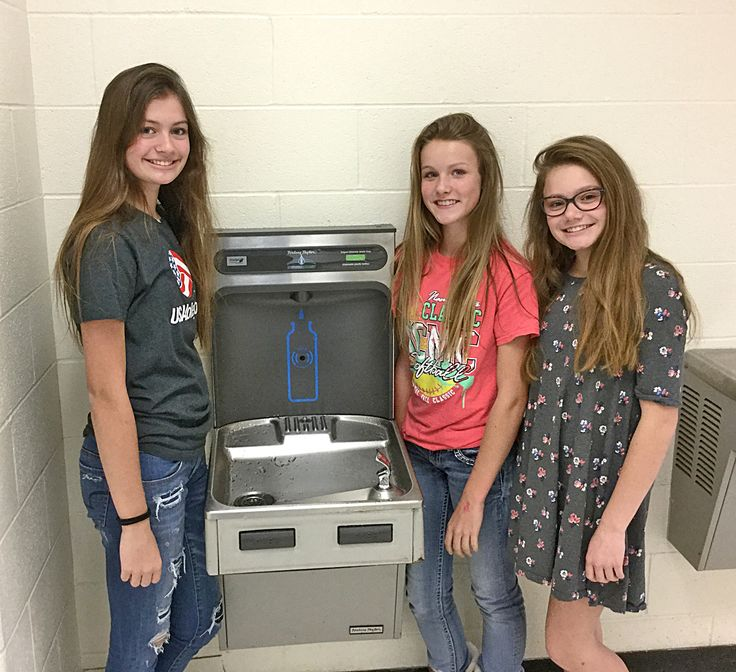 Photo Courtesy of Trenton Middle School FCCLA The Trenton Middle School has a new water bottle filling station, located on the lower water fountain in the middle school commons. FCCLA members, from left, Evelyn McCullough, Lexi Gott and Grace Kennebeck put together a concession stand at a volleyball game  and a potato bar at one of the TMS football games in order to raise half of the money for the project. The Bulldog Booster Club donated the remaining half of the cost. The students and…