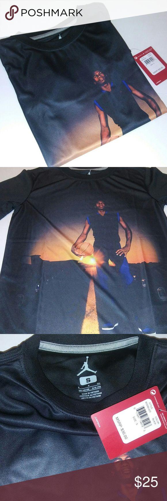 Boys Jordan Shirt Boys black 100% polyester Jordan shirt. The front of the shirt displays Michael Jordan and the back of the shirt is solid black. This is an amazing shirt for Jordan fans!   Size: S Jordan Shirts & Tops