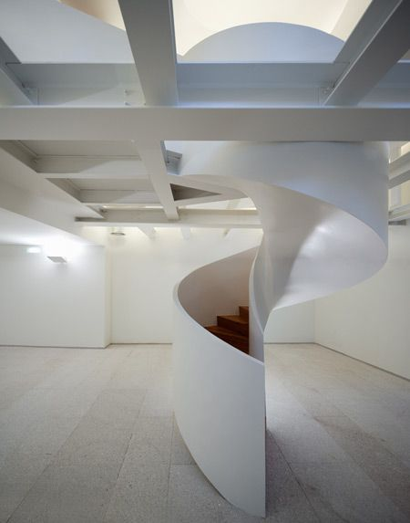 converting an existing 1930s home to a literary centre. Feature staircase in an otherwise empty interior. Portuguese architect Manuel Maia Gomes