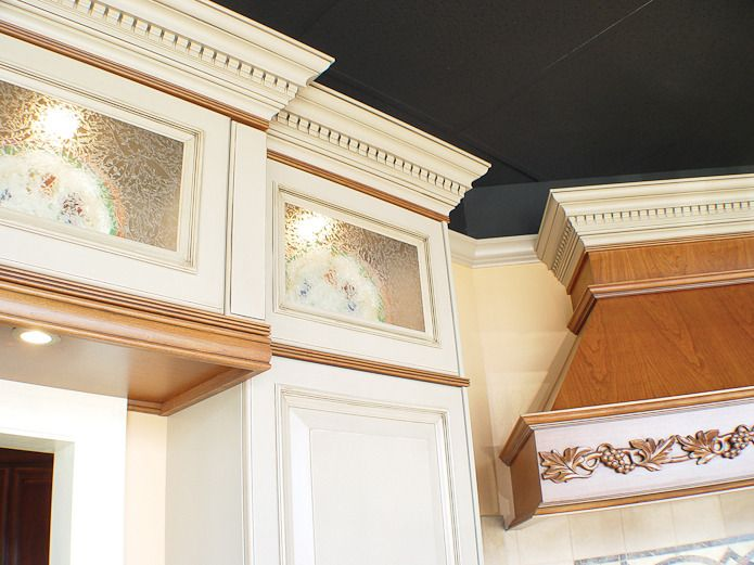 Beautiful mixing of colors here.  Do we have any room for any crown molding?  Kitchen Dentil Crown and Natural Wood Molding. UltraCraft