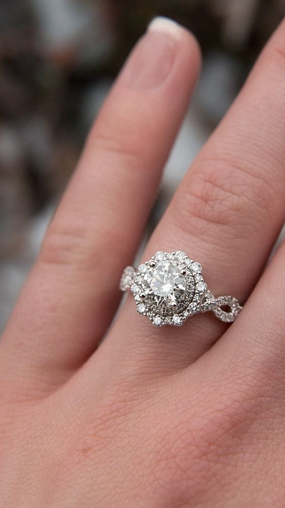 We're absolutely gaga over this TRULY Zac Posen diamond halo engagement ring!  # #TRULYZacPosen #ringselfie #helzberg