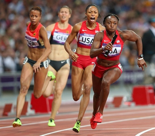 Bianca Knight os the United States receives the relay baton from Allyson Felic on their way to winning gold.  Best Of London: Day 14 - Slideshows | NBC Olympics##