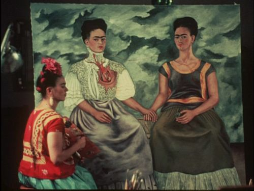 Frida Kahlo painting the Two Fridas~Image by Nickolas Muray, 1938