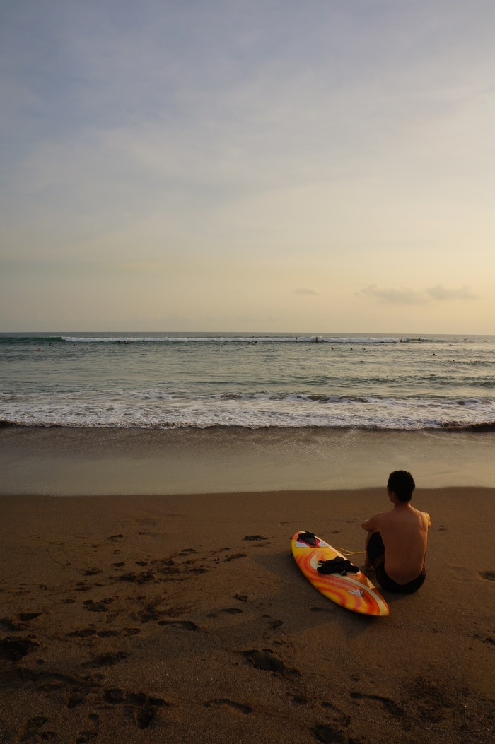 Tranquility. A surfer blowing off some steam after an active day. The Canggu beaches is a great place to watch the sunse...