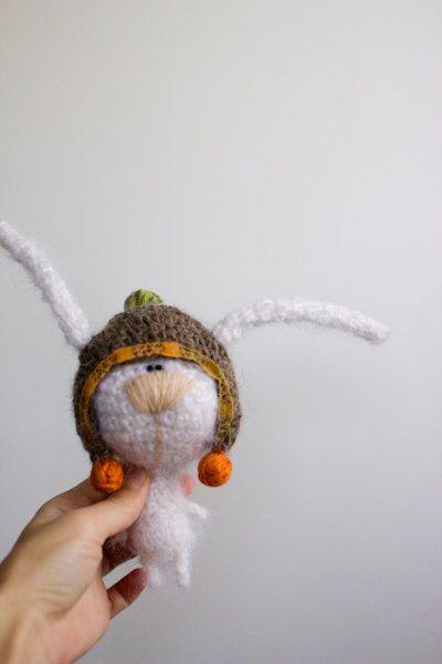 White rabbit in funny hat