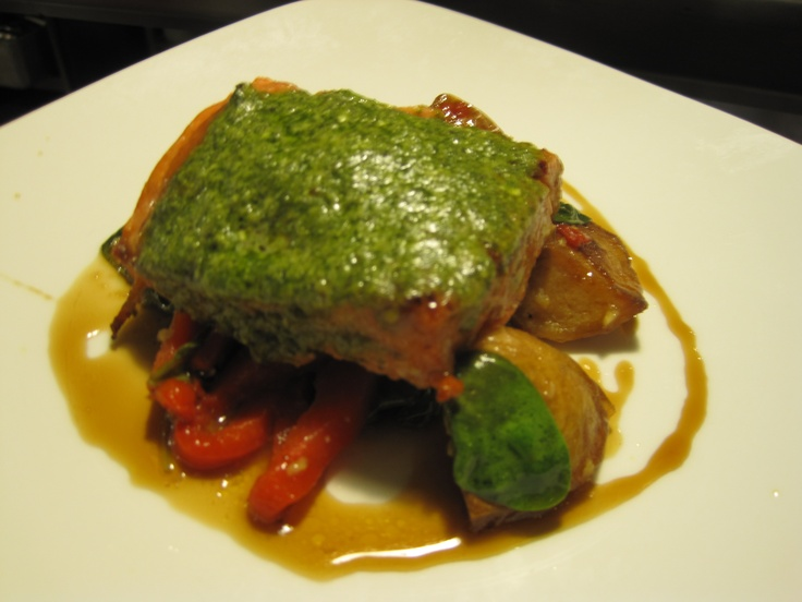 Wild caught salmon with vegan pesto, potato, spinach, and roasted red peppers in sherry reduction.