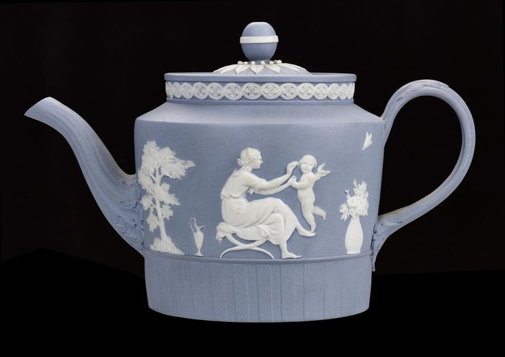 Teapot and cover, pale blue jasper ware with white bas-reliefs of Sporting Love and Charlotte mourning at the tomb of Werther and guilloche band, cover and lower body ribbed, after designs by Lady Templetown: English, Staffordshire, Etruria, by Wedgwood, c. 1787