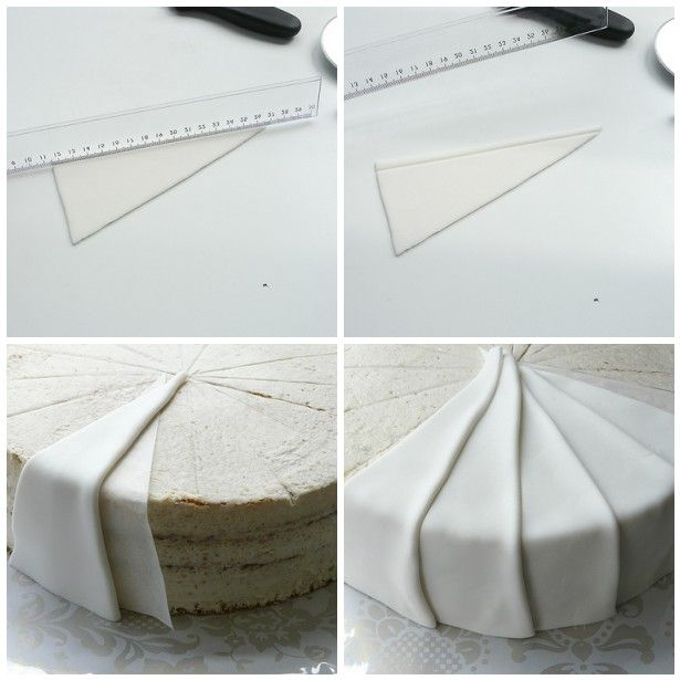 Individually cut pieces of fondant laid over each other... impressive.. lots of impressive pieces on this page..