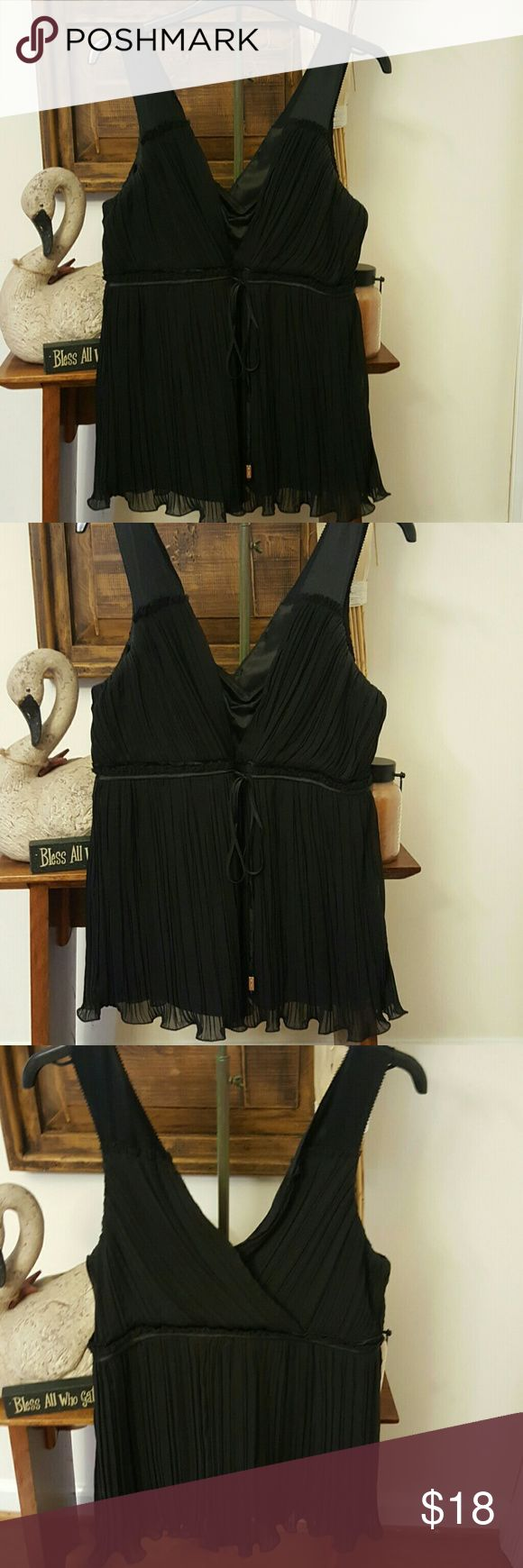 WHBM Black flowing camisole Beautiful black cami with tie in front. Small silver bars are end of ties. V-neck and V-back style. Fabric flows and is pleated. Great condition. Very pretty. White House Black Market Tops Camisoles