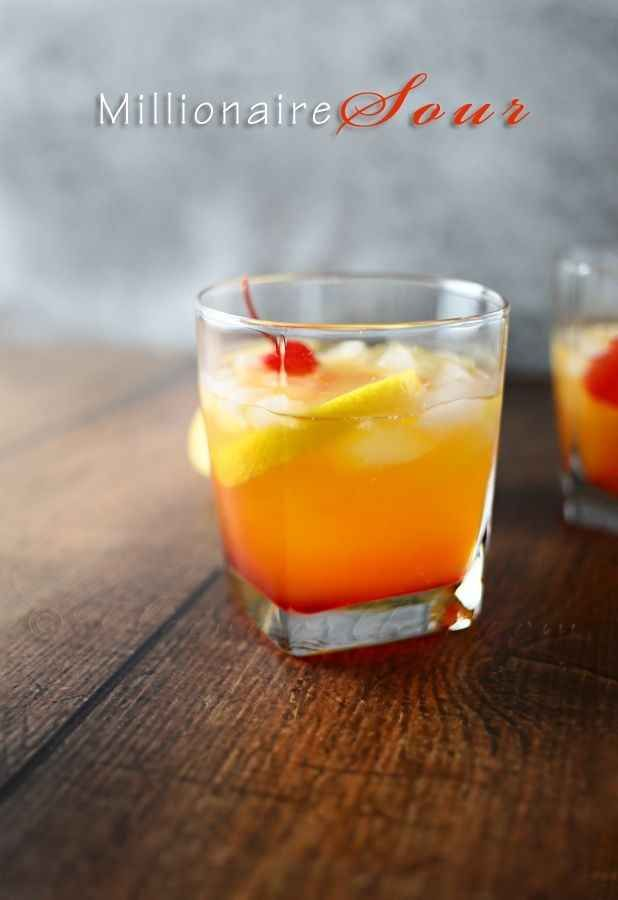 Millionaire Sour  Ingredients  **PER GLASS 2 ounces Lemon Simple Syrup 1 ounce Bushmills Irish Whiskey OR 2 ounces ginger ale if you wish to go non-alcoholic 1/4 cup crushed ice 1/4 shot grenadine lemon slice & cherry for garnish