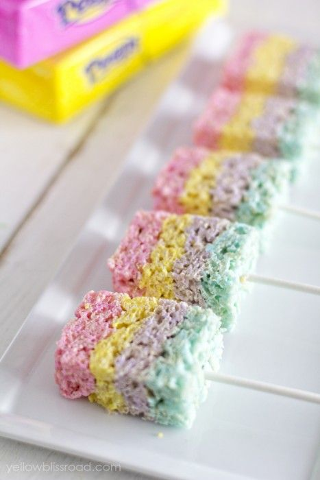 Adorable and delicious Peep colored Marshmallows and Rice Krispies made into a layered treat with lollipop stick.  This simple treat is great to make with the kids and package as a food gift.