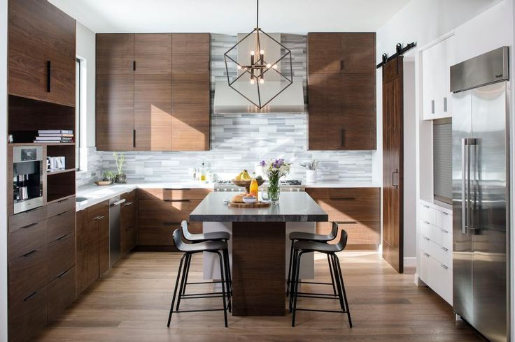 Visit HGTV.com to see how designer Kristianne Watts used stainless appliances, walnut cabinets and geometric light fixtures to pack this modern, open-concept kitchen with personality.