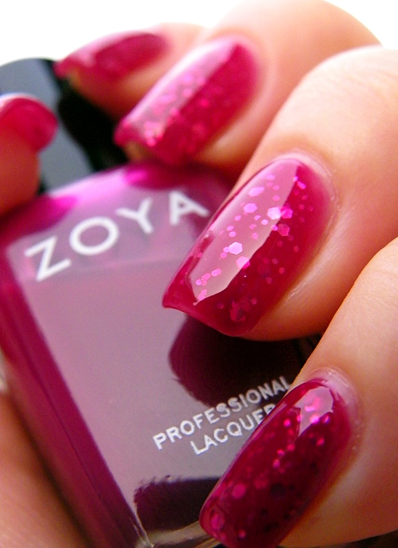 """My Zoya jelly nail polish sandwich! Two layers of Zoya's Paloma; a layer of Sally Girl's baby-pink, medium and small hexagonal glitter polish; a layer of Paloma, another layer of the hex glitter, a final layer of Paloma, and Seche Vite top coat to seal it all off. Did the extra layers for a deeper, extra """"squishy"""" look to the jelly sandwich. #nailart"""