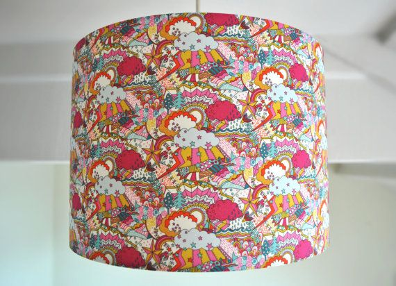 Say hello to our playful Tana Lawn Land of Dreams Liberty fabric lampshade. A gorgeous soft cotton, this design is full of surprises - can you spot the little bird, the rabbit or the tiny toad stall? If you can bear to part with it, this shade would make for a quirky Chrismas present! This lampshade measures 30cm in diameter x 21cm High. The shade in these photos is a ceiling shade - you can order a floor/table if you prefer, simply choose your desired style from the drop-down menu. Ea...