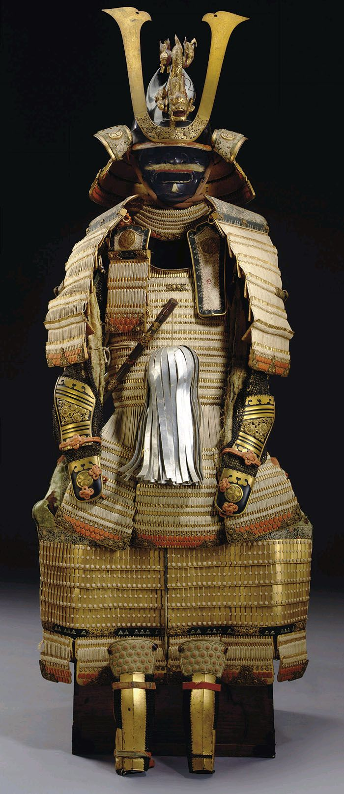 Armor for a Daimyo of the Tokugawa Shogun family. White-laced gold-lacquered nimai-do gusoku. Edo period (18th century) This fine quality armor is in the restoration style initiated by the eighth shogun, Tokugawa Yoshimune (1684-1751), who advocated a return to the samurai virtues of the Kamakura period (1185-1333). The armor is accordingly a hybrid of styles from the Kamakura period, and the tosei gusoku (equipment of the times) dating from the 16th through the 18th century, and persisting…