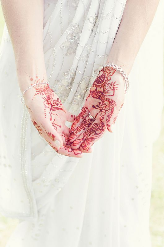 Beautifully ornate bridal henna - such a lovely idea! Image by Natalie Brenner (CC-BY).