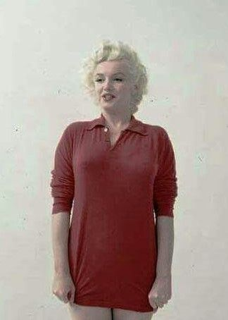 Marilyn Monroe. Red sweater sitting. Photo by Milton Greene, 1955.