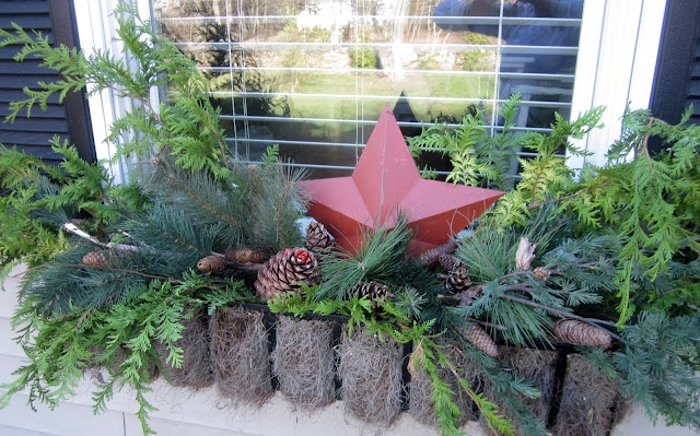 Christmas window boxes from Down to Earth Style: Holiday Curb Appeal
