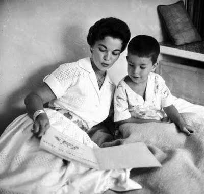 """""""That's a grownup Shirley Temple reading to her son, Charles Black, Jr. in 1957. Nearing the final chapters of her show biz career (but not her diplomatic service), it was during this same period when Temple encouraged reading each time her program """"Shirley Temple's Storybook Theater"""" was broadcast between 1958-1961."""""""