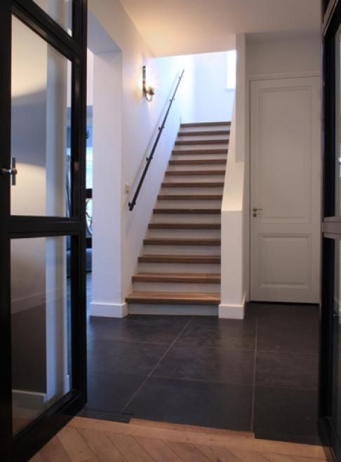 when the treads aren't bull-nosed, the stairs automatically look more modern. squaring off the front creates a clean look. love the minimalist handrail
