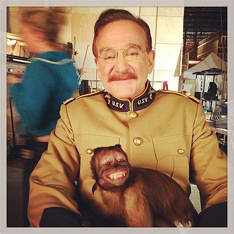 Robin Williams posed with Crystal the monkey on the set of Night at the Museum 3 in April 2014.