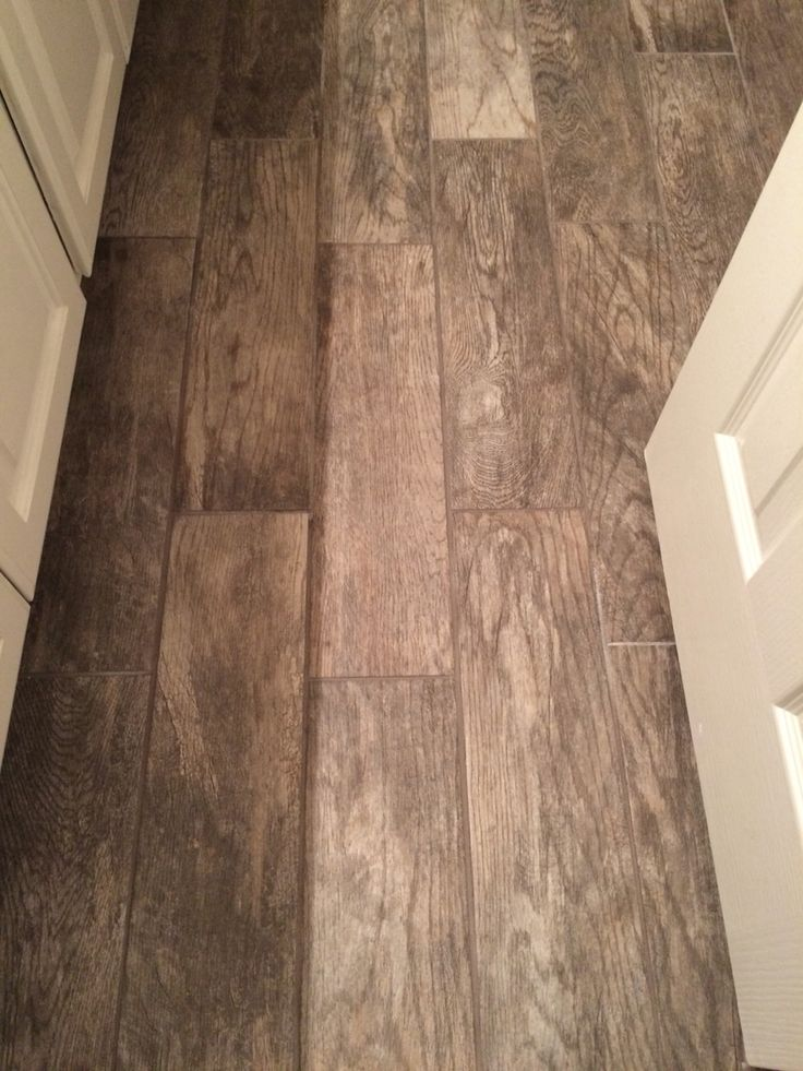 Wood plank looking tile in our bathrooms!