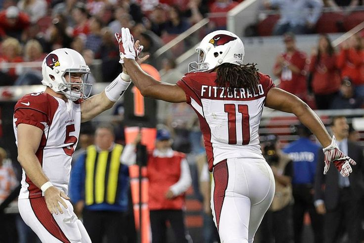 Thursday Night Football: Cardinals vs. 49ers  -  October 6, 2016:  33 - 21, Cardinals  -    Arizona Cardinals quarterback Drew Stanton (5) and wide receiver Larry Fitzgerald (11) celebrate after connecting on a touchdown pass during the first half of an NFL football game against the San Francisco 49ers in Santa Clara, Calif., Thursday, Oct. 6, 2016.