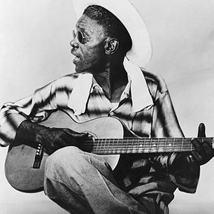 "Sam ""Lightnin'"" Hopkins learned the blues from Blind Lemon Jefferson in the Twenties. He was a ferocious electric stylist in the Fifties, though he's perhaps best known for his nimble acoustic fingerpicking during the Sixties folk-blues revival."
