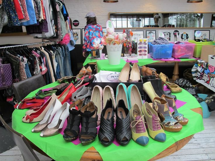 Yard Sale Party - Garage Sale Party - Organize shoes on a round table with tiered platforms
