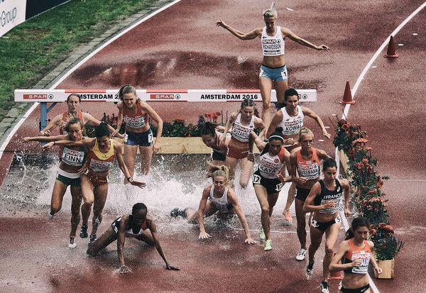 (Editors note: This image has had a digital filter applied to it) Lennie Waite (c) of Great Britain falls at the water jump with Meryem Akda of Turkey during the 3000m Steeplechase Women heat during day three of the 23rd European Athletics Championships at Olympic Stadium on July 8, 2016 in Amsterdam, Netherlands.