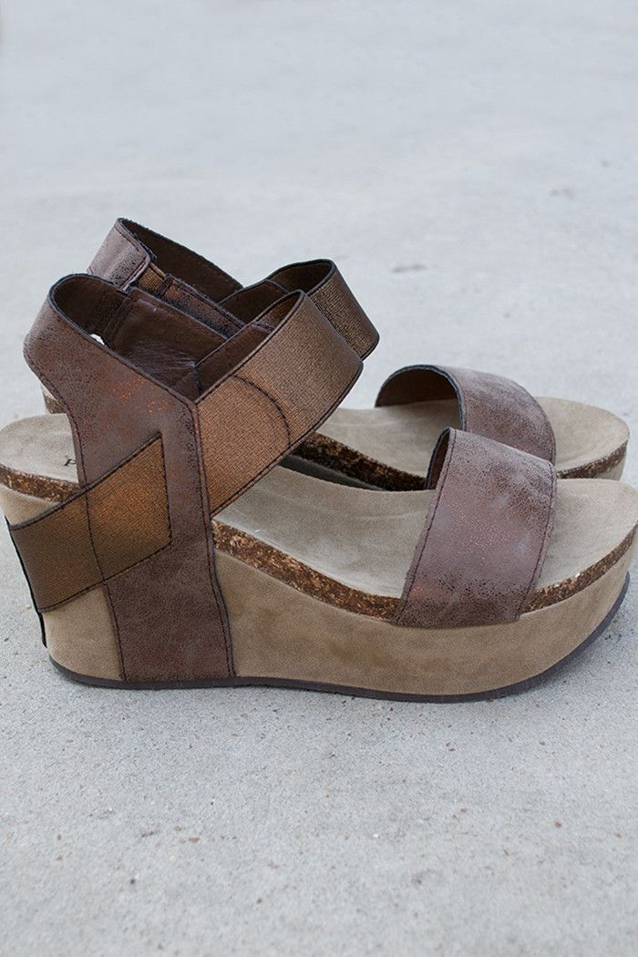 """Copper in color with wide straps and a platform wedge heel measuring 3.5"""" at the highest point on the heel and 2"""" at the highest point on the front platform. The top two bands are flexible with elasti"""