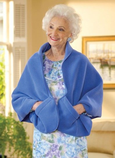 try this for Doris.  Consult with Joyce on collar.  No pattern but item has dimensions.  uses 200 weight fleece.  25 in wide w/2 in lay back collar.  58in long w/rounded ends.  No dimensions given for pockets - they may be slanted.  Make 2 layer neck gaiters for everyone else?