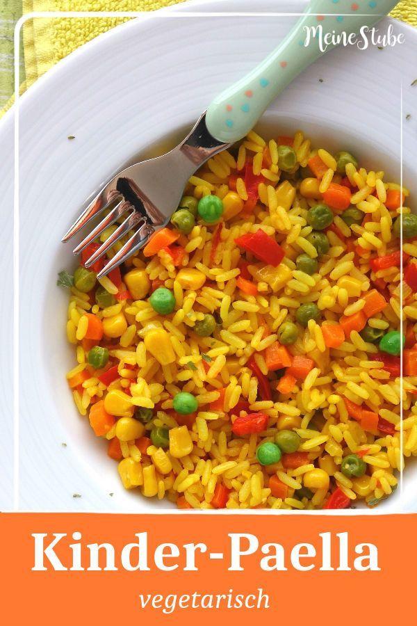 Kinder Paella mit buntem Gemüse, ein vegetarisches Reisgericht
