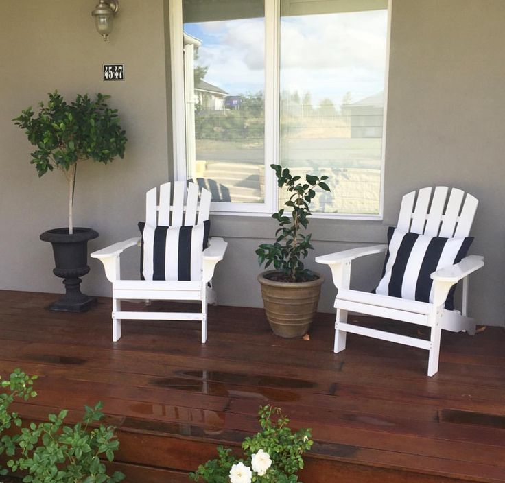 Hamptons styling by @frontporchproperties. Gorgeous white deck chairs with $10 black and white striped IKEA cushions.