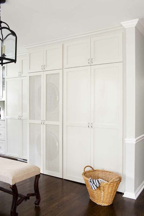 TerraCotta Properties: Amazing hidden laundry room in kitchen with floor to ceiling cream cabinets with stacked ...