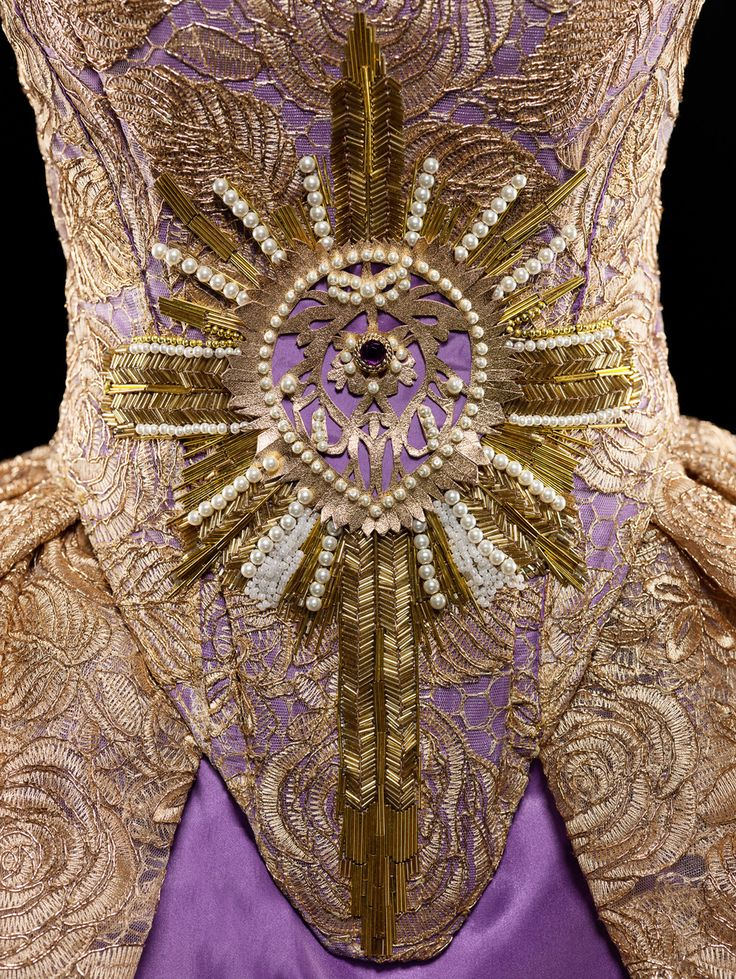 IMAGE © Alexia Sinclair CORSET. HAND EMBROIDERED PEARL, RUBY & BUGLE BEADS WITH HAND CUT GOLD FOILED KANGAROO LEATHER