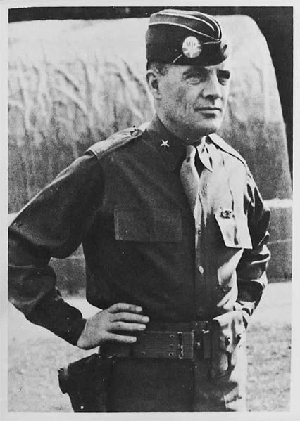 """Anthony Clement """"Nuts"""" McAuliffe (July 2, 1898 – August 11, 1975) was United States Army general who commanded the 101st Airborne Division troops defending Bastogne, Belgium during Battle of the Bulge in World War II. He is famous for his single-word reply to a German surrender ultimatum: """"Nuts!"""" After the Battle of the Bulge, McAuliffe was given command of his own division, the 103rd Infantry Division of the US 7th Army, which he led from January 15, 1945, to July 1945."""