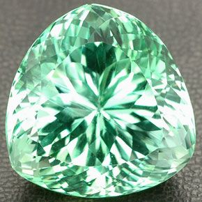 """Hiddenite is the green gem variety of the mineral Spodumene. Spodumene is a common mineral, but only in several localities does it occur in transparent gem form. One gem form of Spodumene is Kunzite, the other important and much rarer form is Hiddenite. Hiddenite is named after William Earl Hidden, who was instrumental in identifying this new gemstone. The town in North Carolina where this gemstone was found was subsequently given the name """"Hiddenite"""" in honor of the gemstone."""