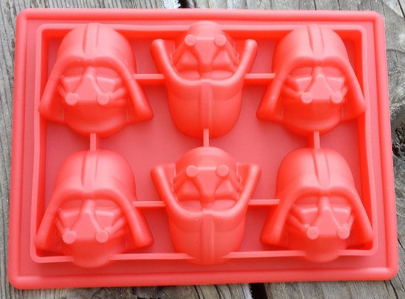 Darth Vader Mask Silicone Mold. Come to the Dark Side. No... really. Its WAY cooler than the light side. These Darth Vader Masks make great ice cubes for the darkest drinks in the universe... Also candy worthy of tempting one to the Dark Side.  6 cavities in the shape of Lord Vaders Mask. Each cavity measures approximately 4.3cm x 4.1cm x 2.1cm.  Listing is for one Darth Vader Mask Silicone Mold.