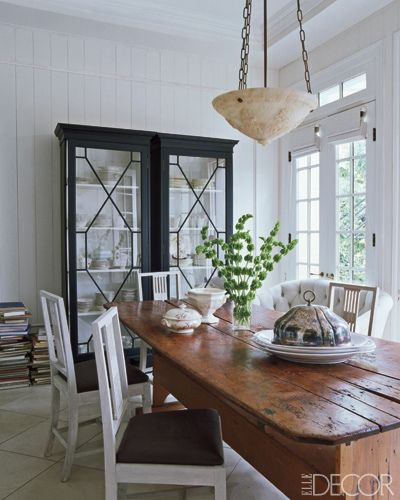 Black cabinet with white interior, modern look with rustic farm table. Love modern and rustic.