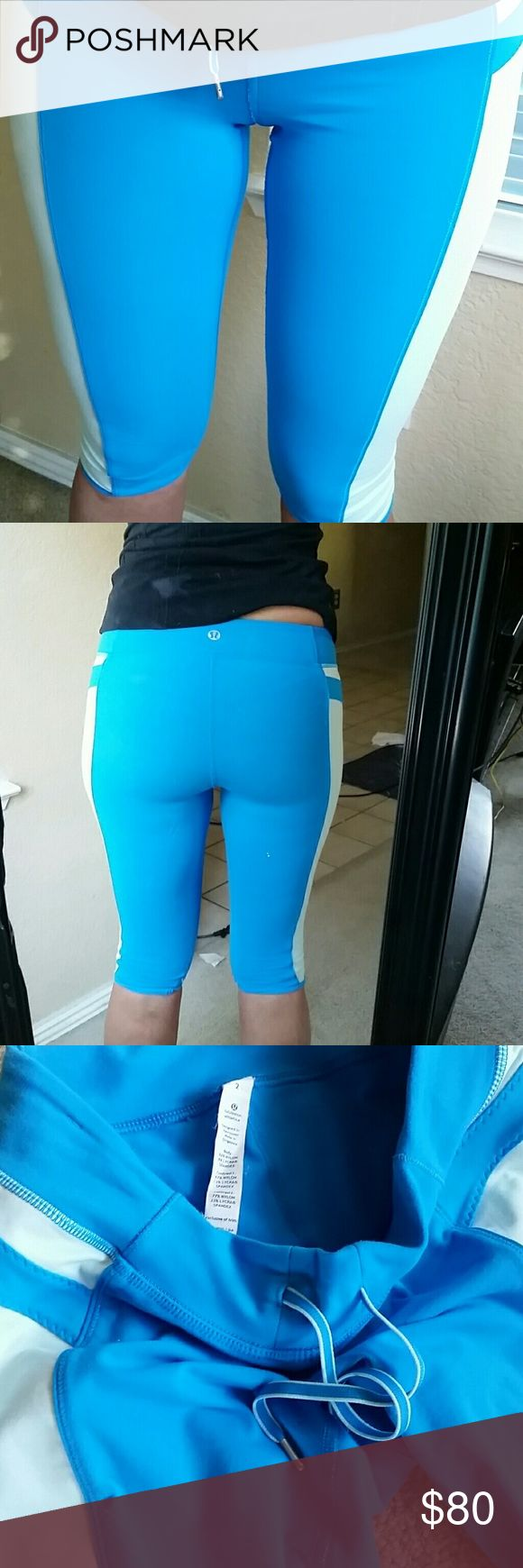 """NEW! Lululemon Seek the Heat Leggings Sz 2 NEW ARRIVAL THIS WEEK! Lululemon athletica blue & white seek the heat crops. I'm 5'3"""" and they're capri length on me (see pics). They've been worn but good condition overall. Just bought these but I prolly won't wear them bc  I mostly wear black leggings at the gym. Looking to sell, or trade for Lulu sz 2-4. Make an offer! lululemon athletica Pants Capris"""
