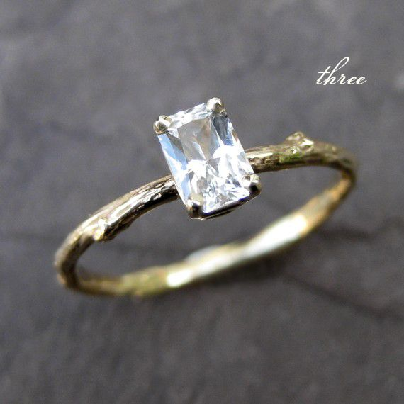 Put a round diamond in it and you've got a YES!   Love how woodsy it is.  http://www.etsy.com/shop/kristincoffin